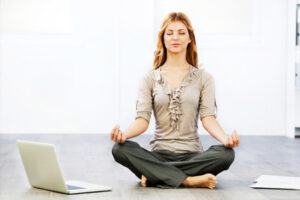 business-woman-doing-yoga-horiz